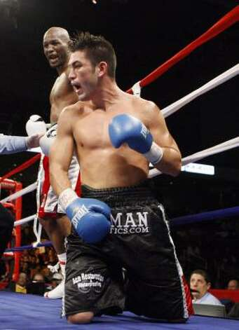 Enrique Ornelas reacts after being knocked down by Bernard Hopkins in the eighth round. Photo: Matt Slocum, AP