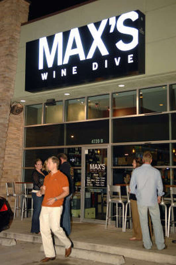 With wintry weather here, a quiet evening with a bottle of wine is an great way to warm up with friends. These local wine bars are the perfect place to get cozy and enjoy the weekend. Max's Wine Dive, 4720 Washington Ave., is a quaint, little wine bar with a great food and wine menu. Photo: Tre' Ridings, For The Chronicle