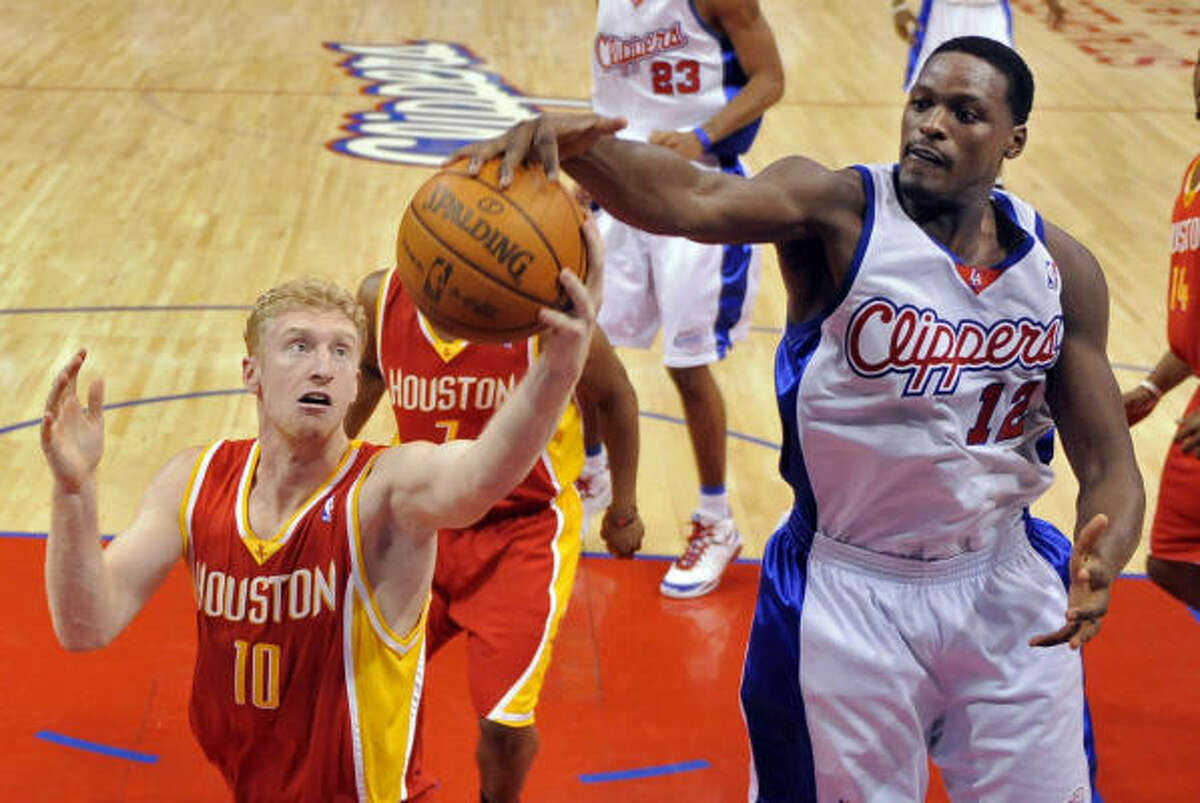 Dec. 2: Rockets 102, Clippers 85 Rockets forward Chase Budinger and Clippers forward Al Thornton reach for a loose ball during the first half.