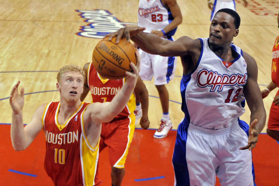 Dec. 2: Rockets 102, Clippers 85Rockets forward Chase Budinger and Clippers forward Al Thornton reach for a loose ball during the first half. Photo: Mark J. Terrill, AP