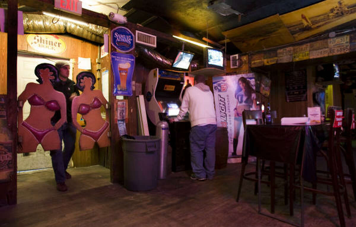 Mike Hoistad walks through the signature swinging doors at the Outpost Tavern.