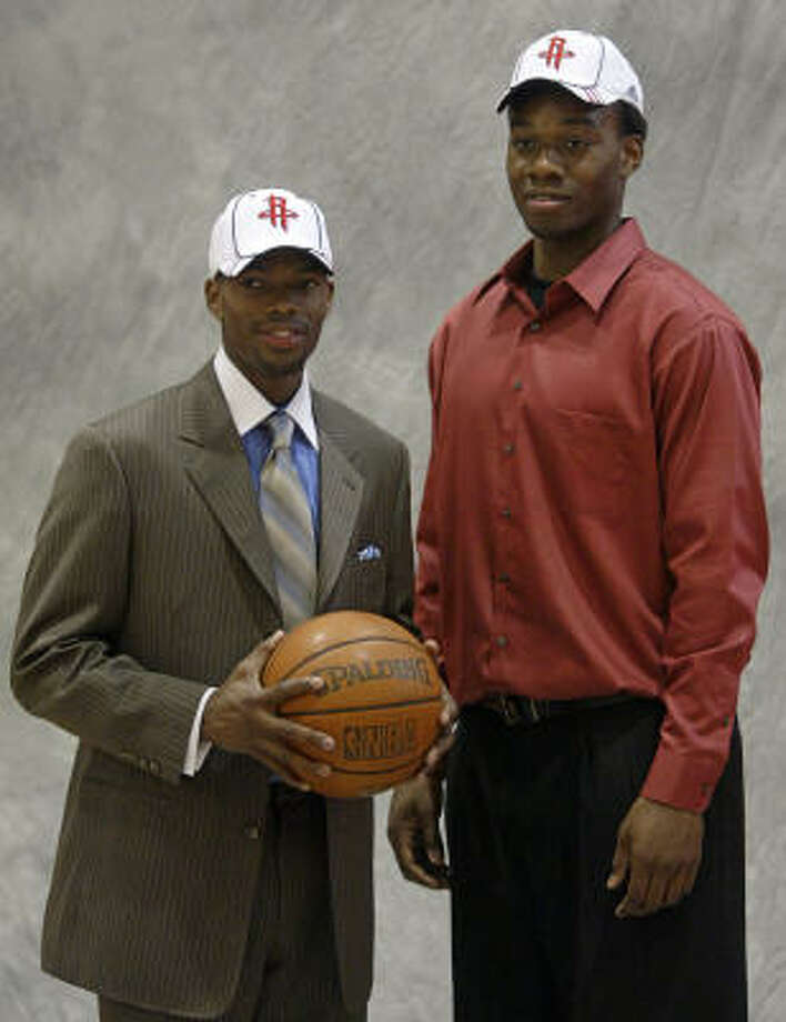 With the 26th pick of the 2007 NBA Draft, the Houston Rockets selected guard Aaron Brooks, left, from the University of Oregon. The Rockets selected Carl Landry, right, in the second round. Photo: Jessica Kourkounis, For The Chronicle
