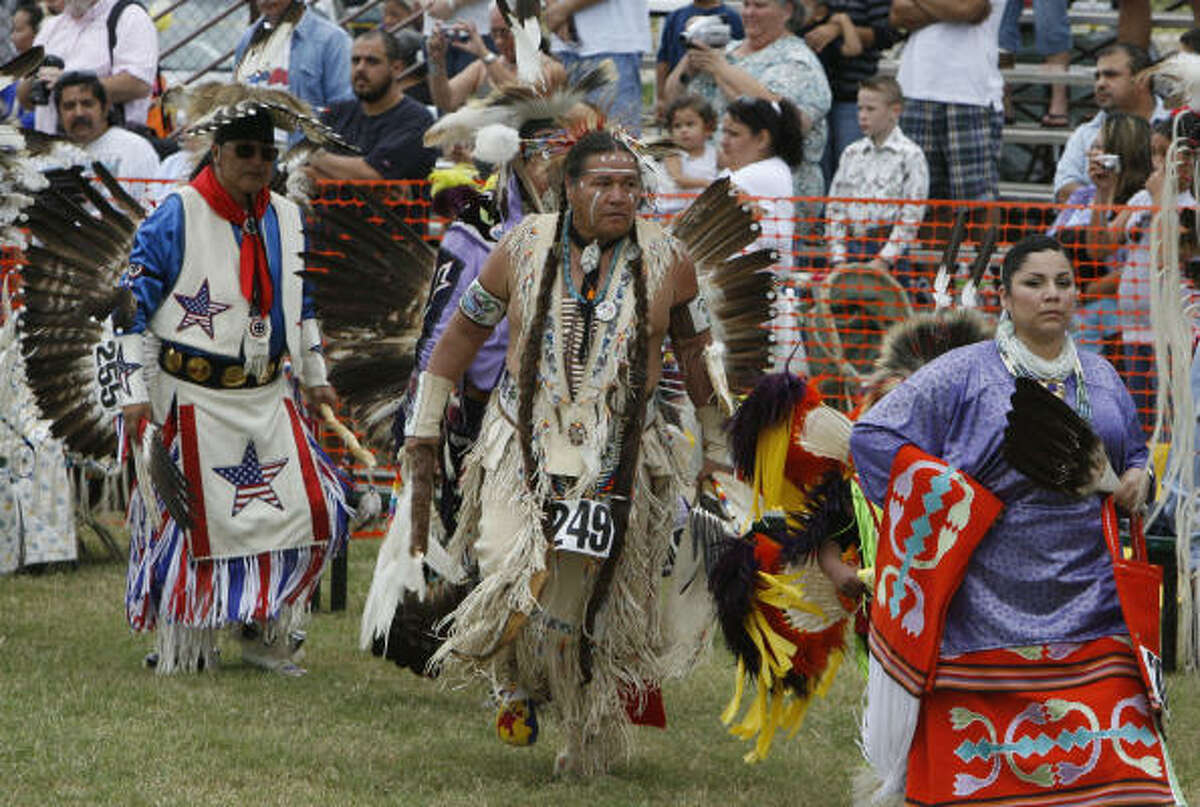 Native American dancers are seen during ceremony at the 20th Annual Texas Championship Pow Wow at Traders Village on Sunday, Nov. 15, 2009, in Houston.