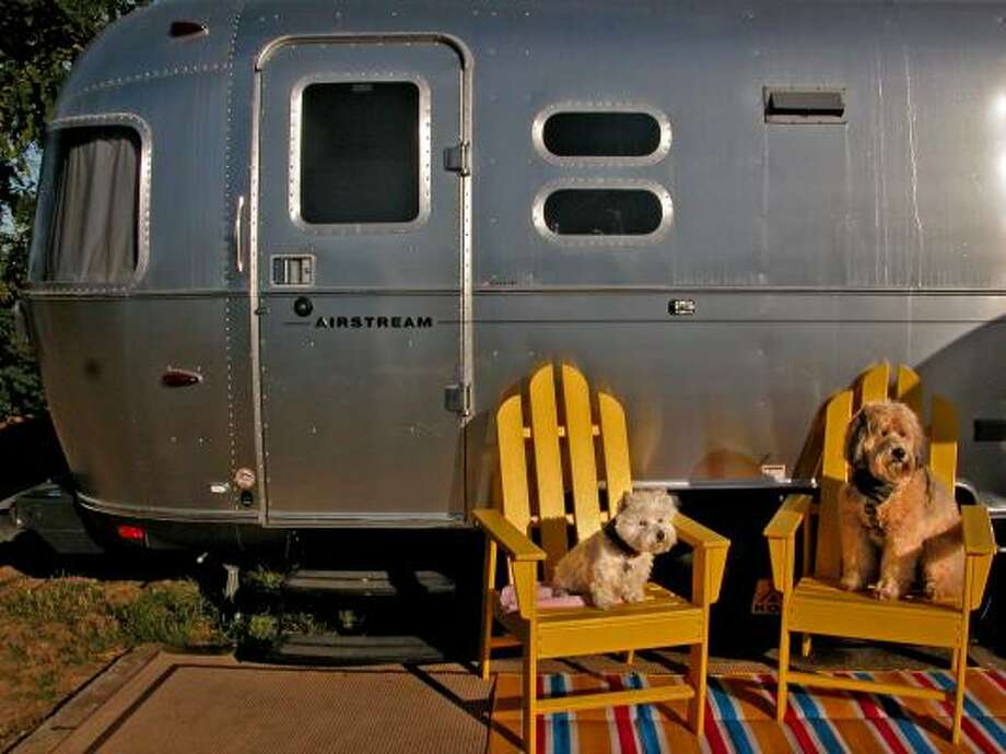 Bonnie, left, a West Highland terrier, and Darby, a wheaten terrier, go on a cabin-camping trip with their humans along a Northern California route that included parks known for their pet-friendly amenities. At the Santa Cruz / Monterey Bay KOA they stayed in a $150-a-night Airstream trailer at at campground includes a dog agility course and fenced play park. Photo: Rosemary McClure, For The Times