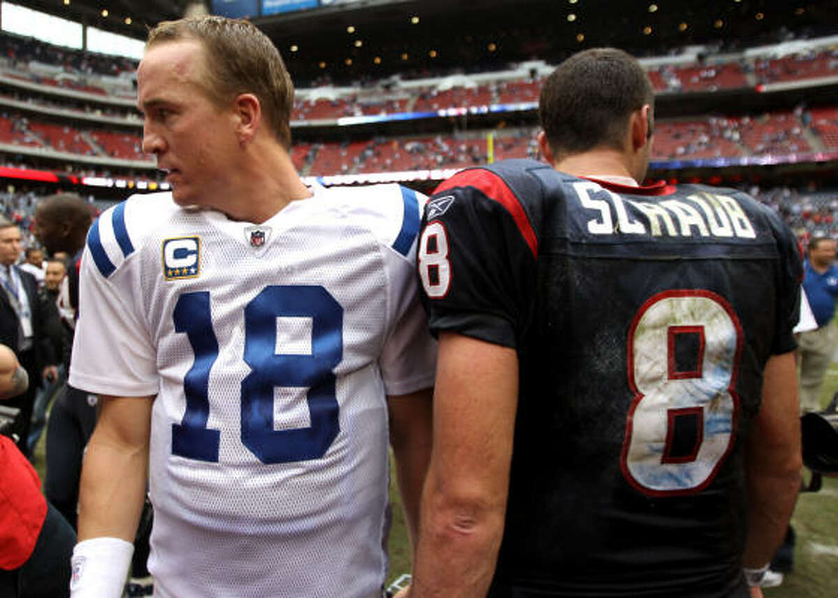 Colts quarterback Peyton Manning and Texans quarterback Matt Schaub walk away from each other after the Colts beat the Texans.