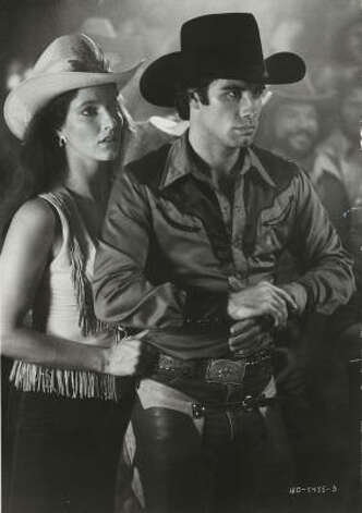 "John Travolta prepares to ride the mechanical bull at Gilley's in ""Urban Cowboy."" Photo: Paramount Pictures"