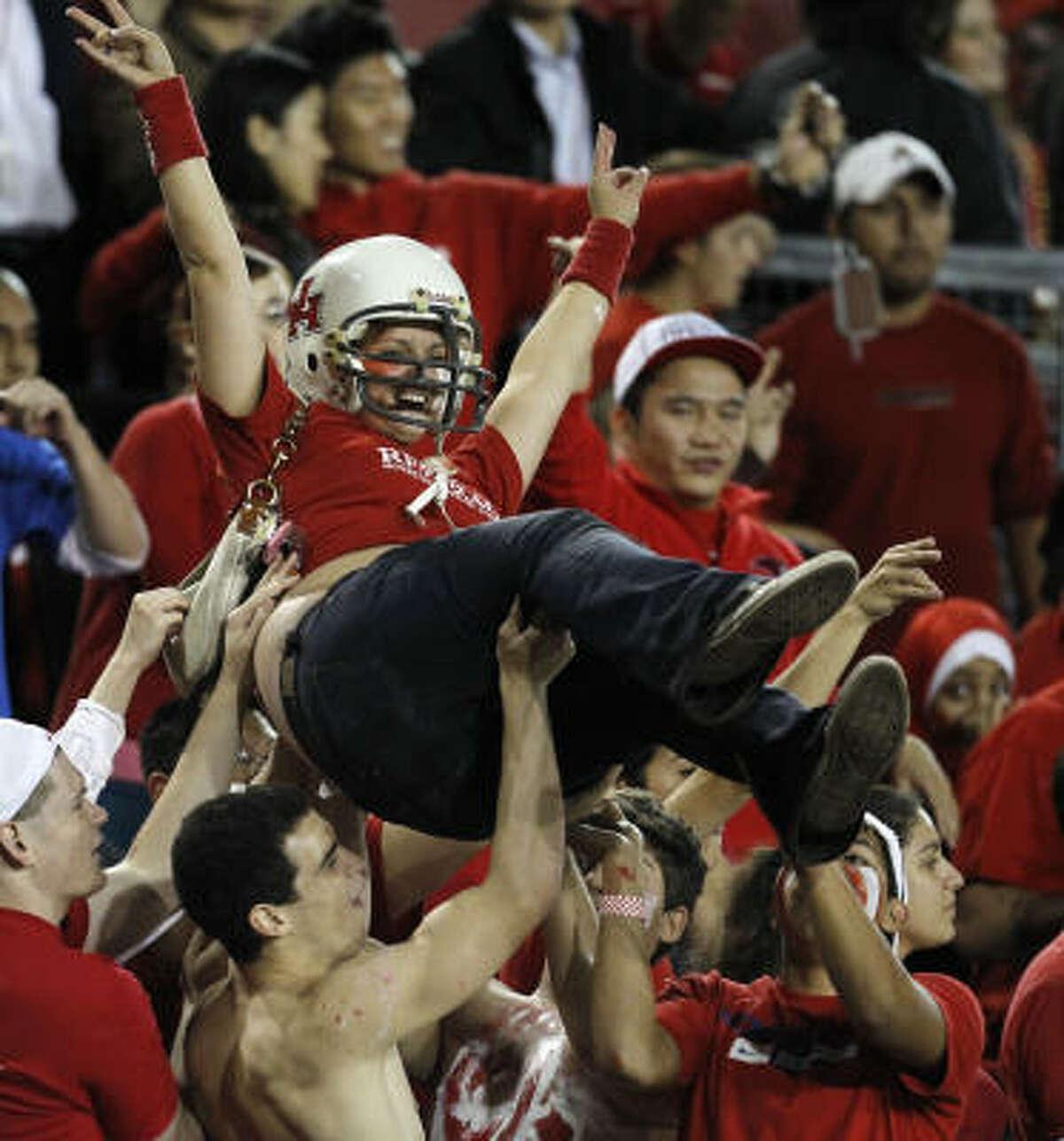 A UH fan crowd surfs after a first-half touchdown.