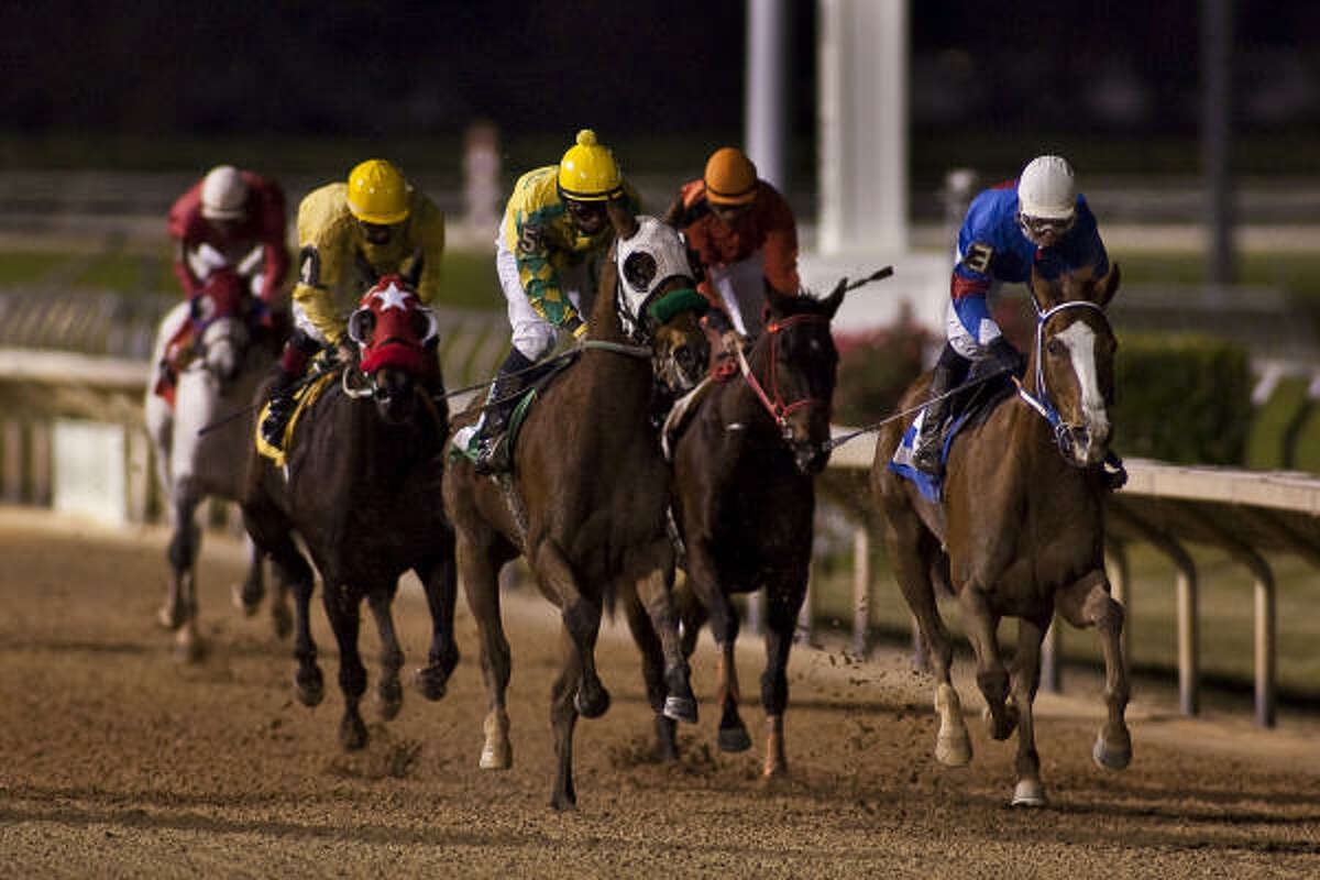 Msdiamondcity, center, and jockey Carlos Marquez wins the Six Furlongs Maiden Claiming race during Friday's opening day at Sam Houston Race Park. Robielee, ridden by Jeremy Collier, took second, and Kelsi Purcell on Weekend Song took third in the evening's second race.