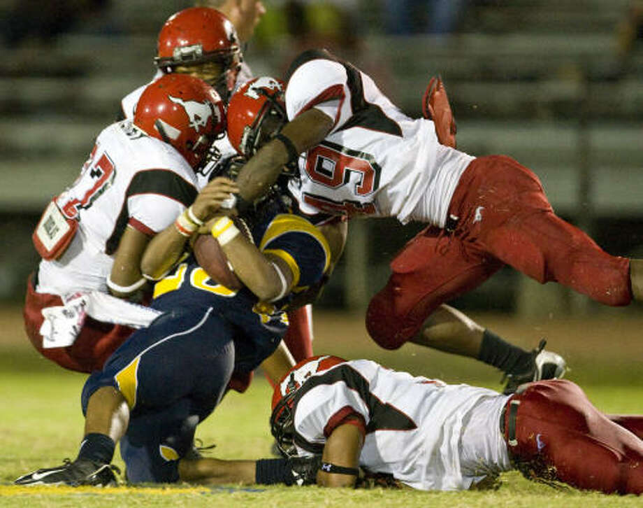 When: Sept. 18 Hitter: The North Shore defense, top. Who was hit? La Marque's Timothy Wright. Outcome: North Shore 44, La Marque 34. Photo: Nick De La Torre, Chronicle