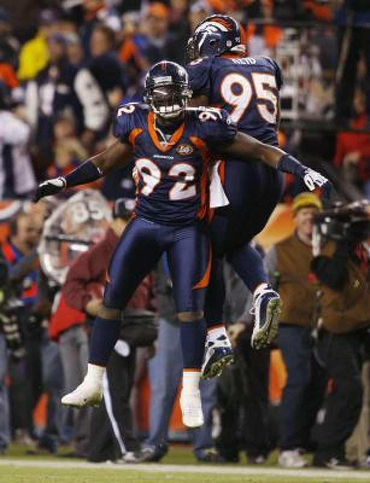 Broncos 26, Giants 6 Broncos defensive end Elvis Dumervil (92) and defensive tackle Darrell Reid (95) react after Dumervil sacked New York Giants quarterback Eli Manning.