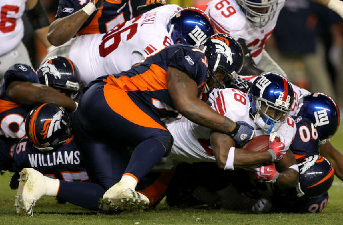 Giants running back Danny Ware gets stopped after a rush.