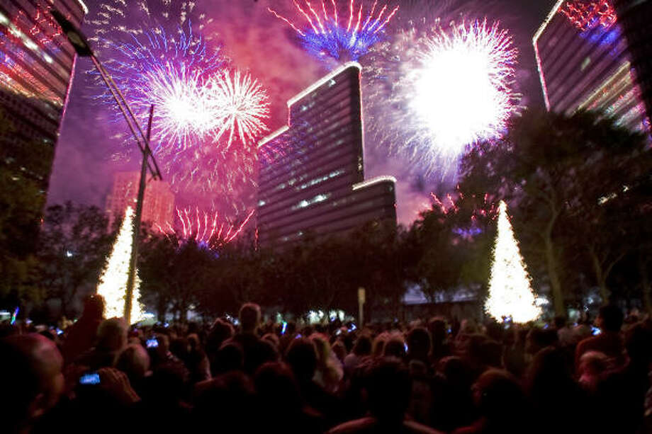 About 100,000 people gathered at Uptown Holiday Lighting along Post Oak Boulevard. Photo: Johnny Hanson, Chronicle