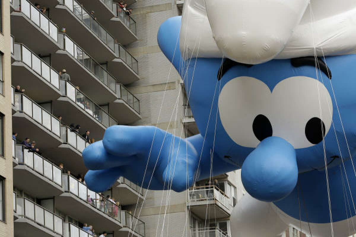 The Smurf float is guided across Central Park South today during the Macy's Thanksgiving Day Parade. For the first time in its more than 80-year history, the parade route is bypassing Broadway, which cuts a diagonal slice through Manhattan, as it makes its way south from the Upper West Side to the finish at Macy's flagship store in Herald Square.