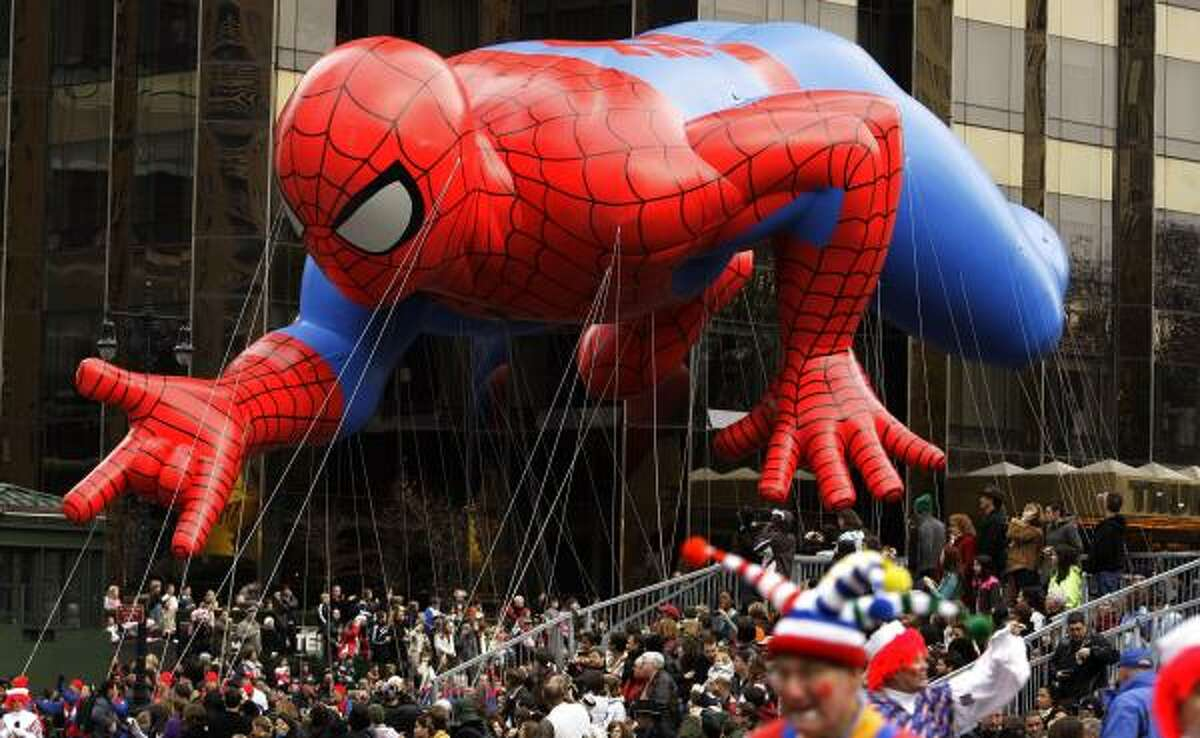 The Spiderman float is guided across Central Park South today during the Macy's Thanksgiving Day Parade in New York.