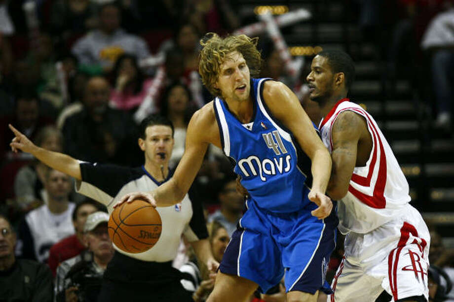 Trevor Ariza, right, and the Rockets had trouble containing Dallas forward Dirk Nowitzki, who scored 25 points in the Mavericks' 130-99 win Wednesday night at Toyota Center. Photo: Michael Paulsen, Chronicle