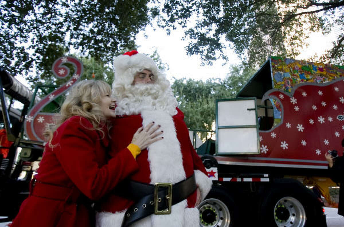 Superfeast event organizer and chair, Tammy Bohon is greeted by Santa Claus as setup began for tomorrow's Superfeast outside of City Hall.