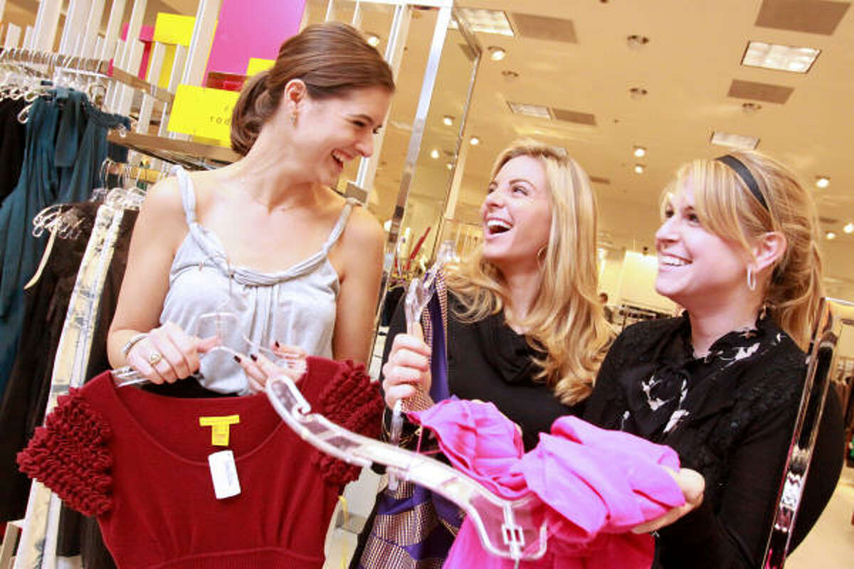 From left, Brittany Cassin, Kristen Nix and Traci Thompson at Girls Night Out at Neiman Marcus.