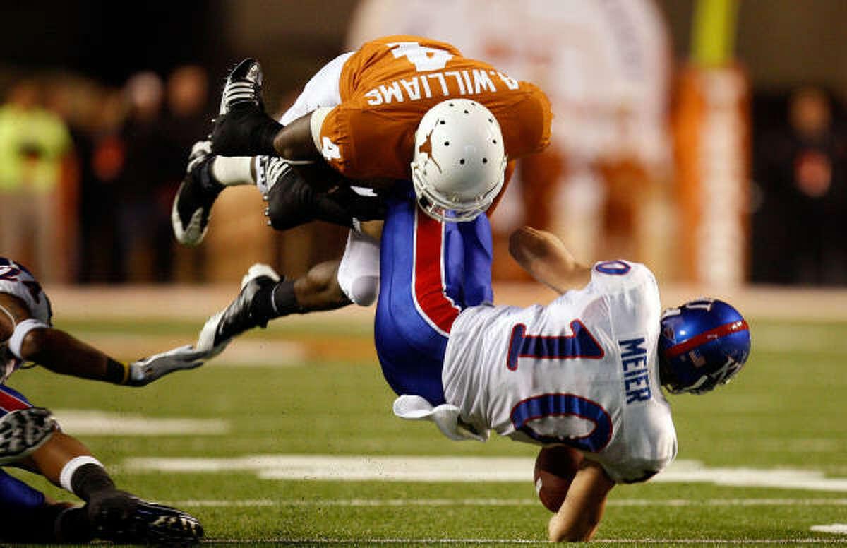Texas defensive back Aaron Williams tackles Kansas receiver Kerry Meier. The Longhorns rank No. 9 in pass efficiency defense.