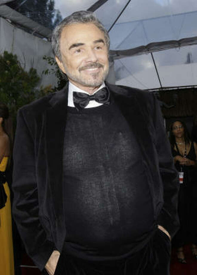 Formerly rugged actor Burt Reynolds looks like his lips are stretched so far from plastic surgery that the smile is permanent. Photo: Kevork Djansezian, AP