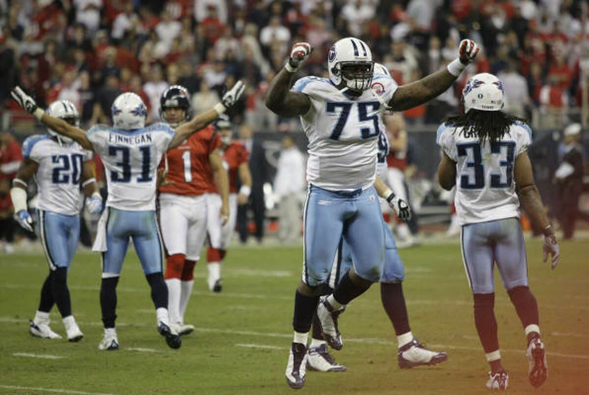Titans defensive tackle Jovan Haye (75) celebrates after a missed field goal by Texans kicker Kris Brown at the end of the game.