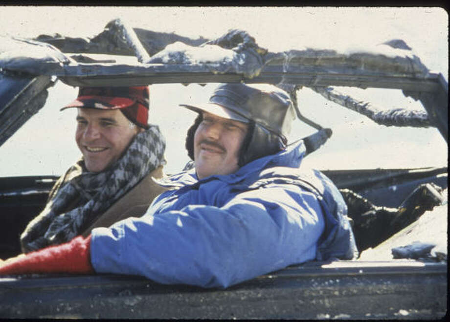 "'Planes, Trains and Automobiles'- Comedy legends Steve Martin and John Candy take a road trip in ""Planes, Trains and Automobiles."" Photo: Paramount Pictures"