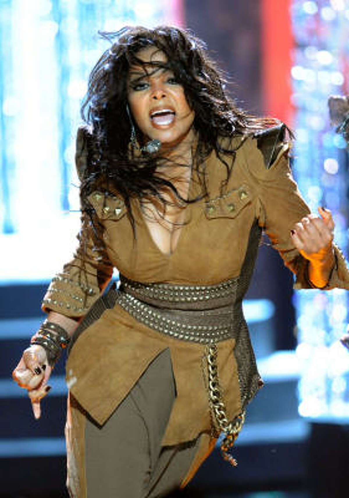 Janet Jackson performs at the American Music Awards. See who else was there.