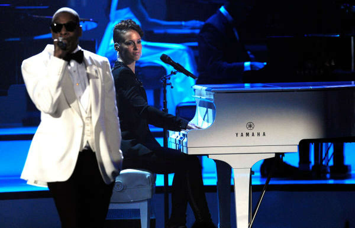 Jay-Z and musician Alicia Keys perform onstage.