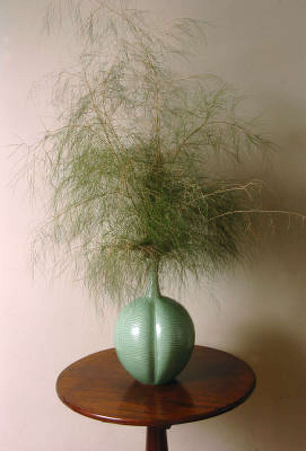 Bamboo muhly This tablescape | Holiday topiaries | Moss wreath | Other people's wreaths :: HoustonGrows.com