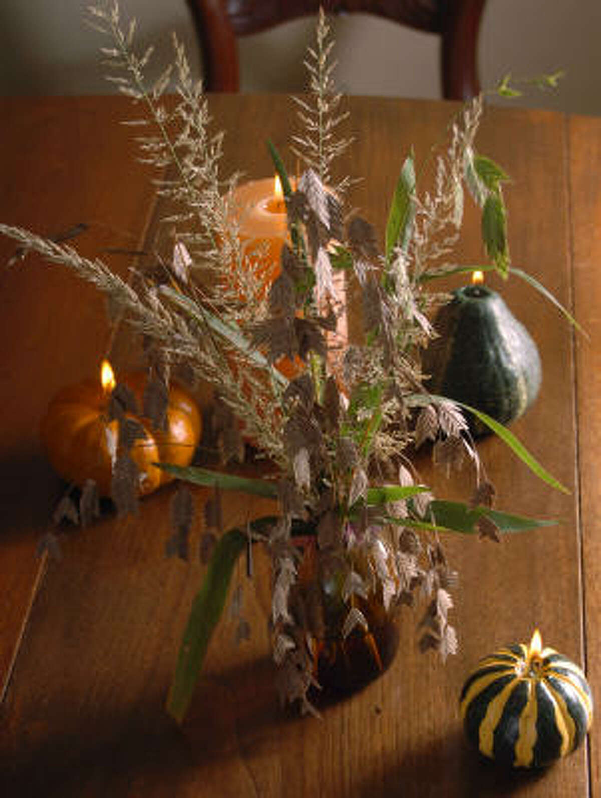 An arrangement of sea oats This tablescape | Holiday topiaries | Moss wreath | Other people's wreaths :: HoustonGrows.com