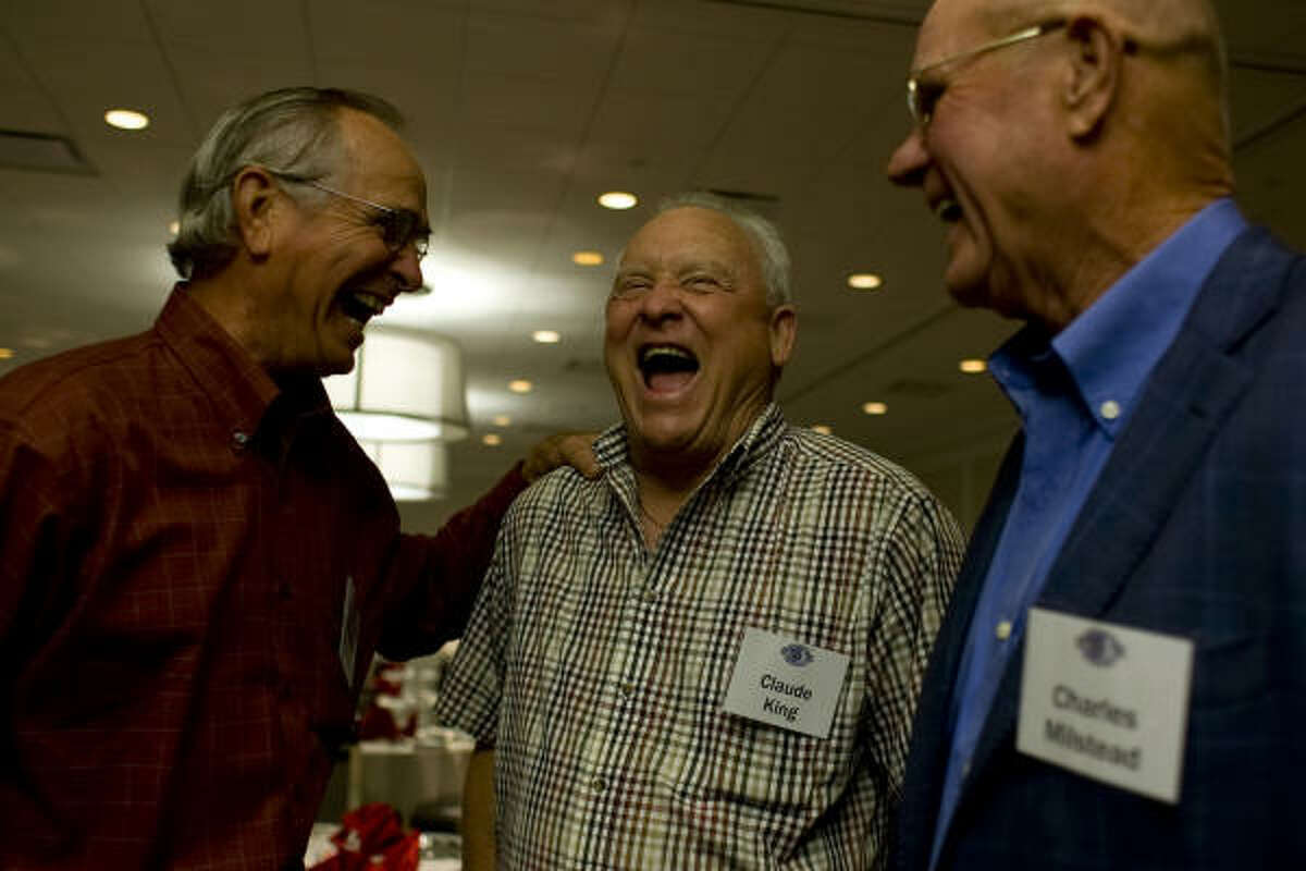 (From left) Former Houston Oilers Tony Banfield, Claude King and Charles Milstead share a laugh before a reception honoring the Oilers' 1960 and 1961 championship teams Sunday at the Westin Galleria Houston hotel.