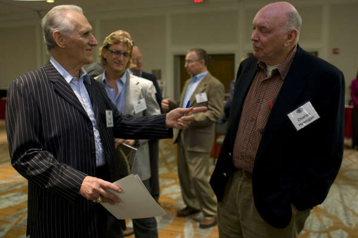 Former Houston Oiler wide receivers Charlie Hennigan, right, and Bill Groman were two of many that reunited during Sunday's reception.