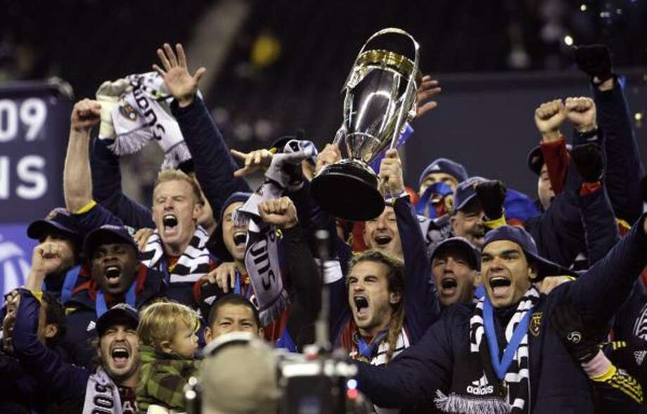 Real Salt Lake players celebrate after beating the Los Angeles Galaxy in Sunday's MLS Cup in Seattle. Real Salt Lake won the championship on a penalty kick shootout. Photo: Elaine Thompson, AP