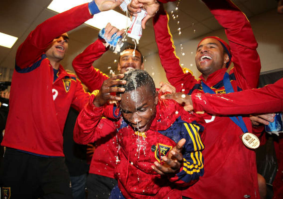 Real Salt Lake's Alex Nimo is doused in beer by teammates following their win in the MLS Cup.