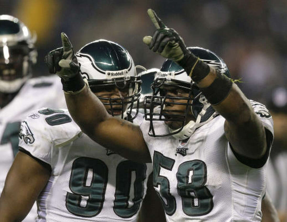 Nov. 22: Eagles 24, Bears 20 Eagles defensive end Trent Cole (58) celebrates with teammate Darren Howard (90) after sacking Bears quarterback Jay Cutler in the third quarter.