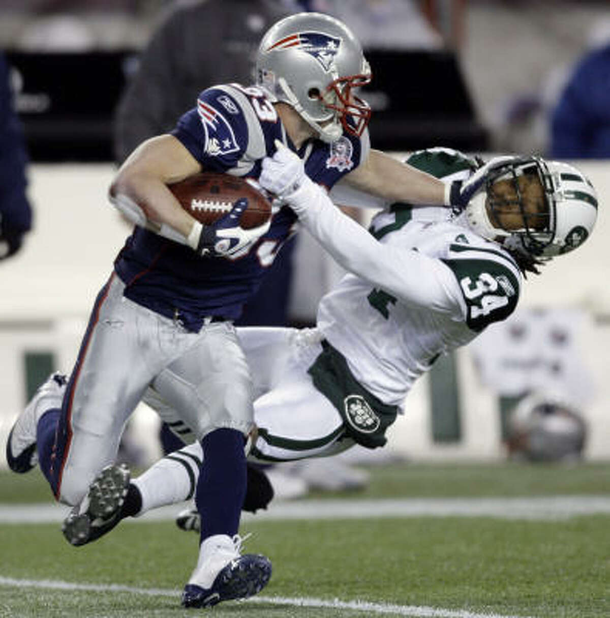 Nov. 22: Patriots 31, Jets 14 Patriots wide receiver Wes Welker puts a stiff-arm on Jets cornerback Marquice Cole.