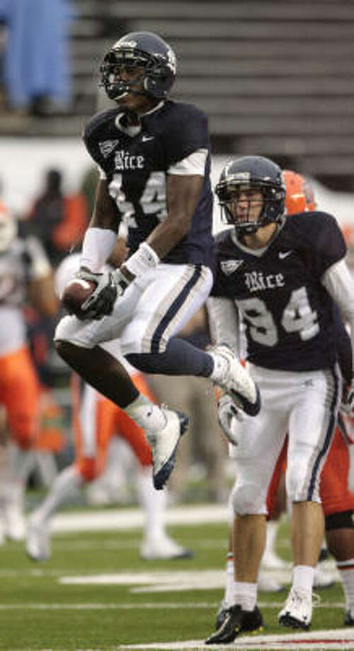Rice defensive back Chris Jones celebrates after picking up a fumble on a kickoff return during the fourth quarter of Saturday's game against Texas-El Paso. Photo: Billy Smith II, Chronicle