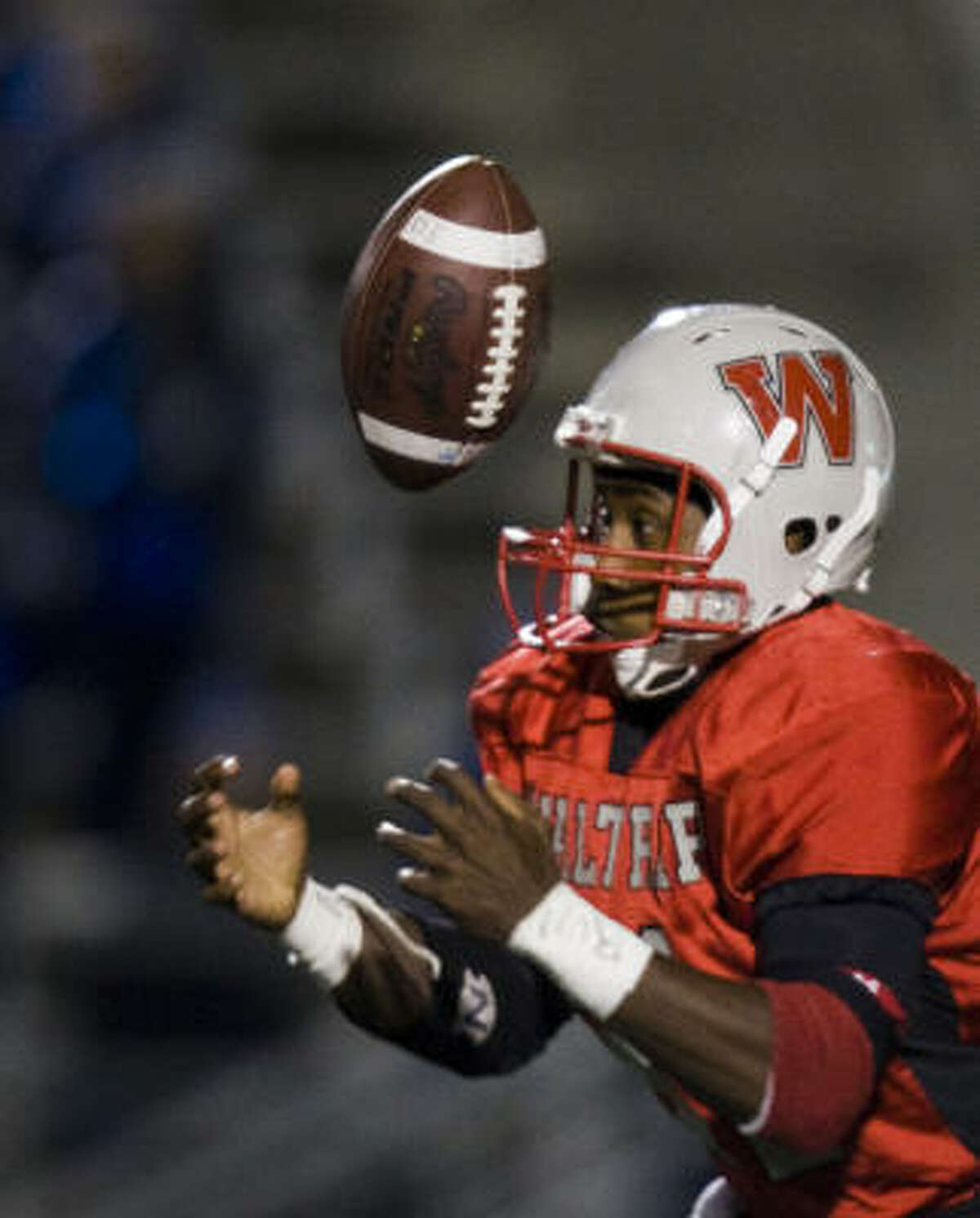 Waltrip running back Cameron Brown bobbles a pitch but was able to haul it in.