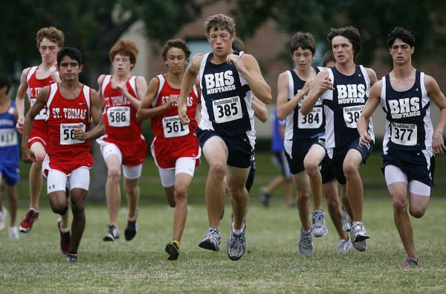RICE INVITATIONAL:St. Thomas and Briarwood School runners jump off the starting line for the boys race at the Rice Invitational Cross Country Meet held at the Rice University campus on September 19. Photo: Diana L. Porter, For The Chronicle