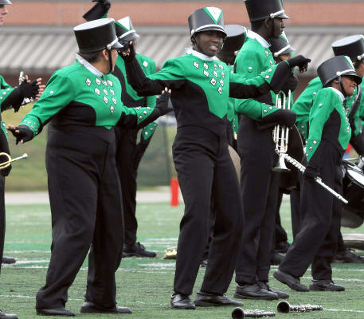 HIGHTOWER 21, WEST BROOK 26: Hightower band members dance during their halftime performance at the playoff game against Beaumont West Brook at Galena Park.