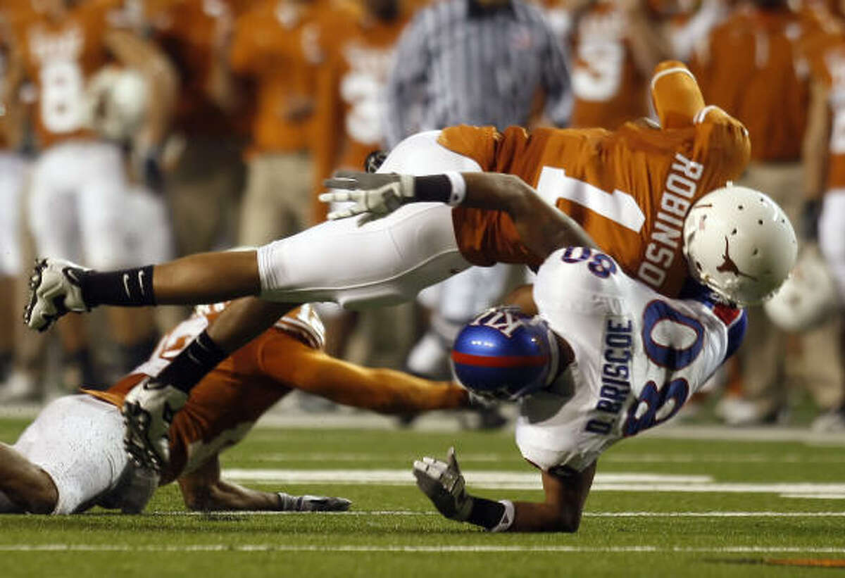 Kansas receiver Dezmon Briscoe (80) is hit by Texas linebacker Keenan Robinson for an incomplete pass in the second quarter.