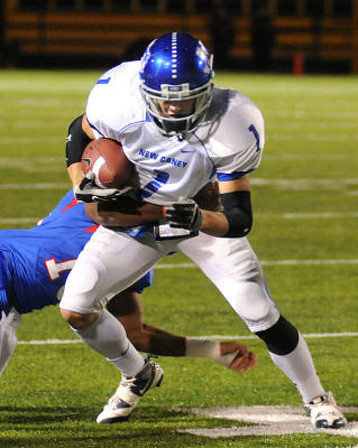 New Caney's Joey Hibner makes a tackler miss. Photo: David Hopper, For The Chronicle