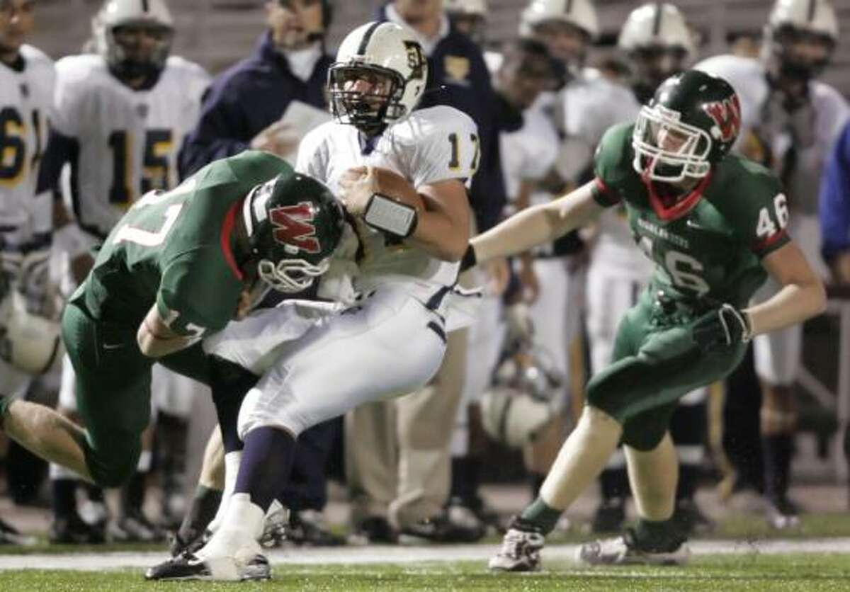 The Woodlands' Tanner Olson (left) sacks Round Rock-Stony Point's Aaryn Sharp as fellow Highlander Brian Nordstrom closes in.