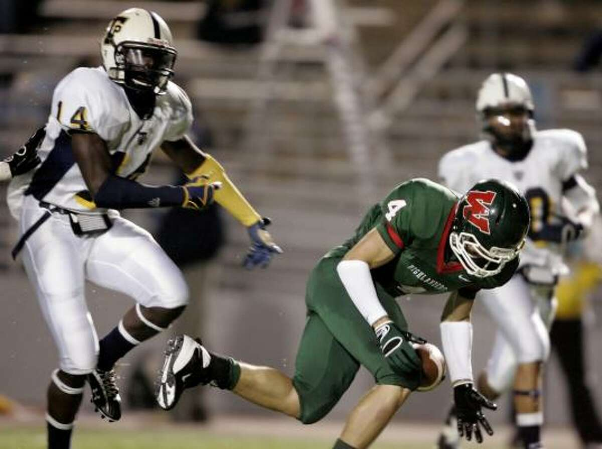 The Woodlands' Peter Falivene can't hold onto a pass as Round Rock-Stony Point defenders Desmond Martin (14) and John Howell look on.