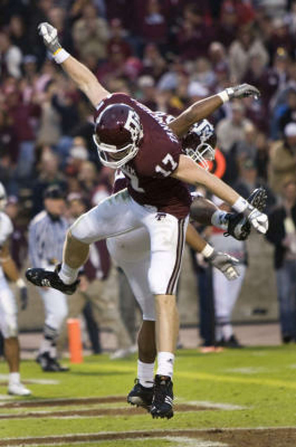 Texas A&M quarterback Ryan Tannehill (17) celebrates his seven-yard touchdown reception against Baylor with teammate Bradley Stephens during the fourth quarter of Saturday's game in College Station.