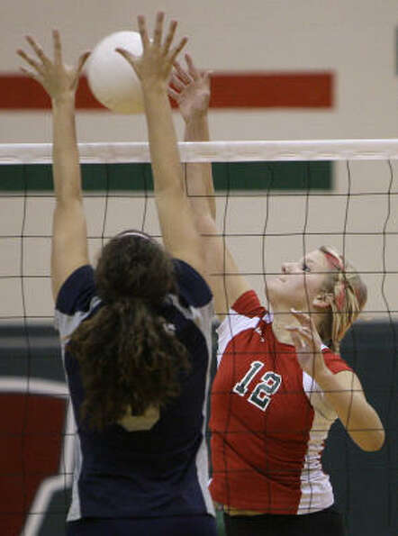 College Park's Alissa Blevins works to block the shot by The Woodlands' Makenzie Kink.