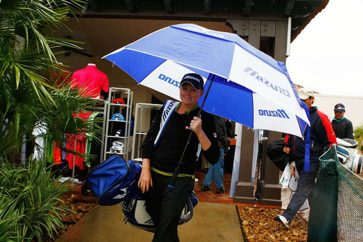Stacy Lewis of The Woodlands leaves the clubhouse after play was delayed Saturday morning.