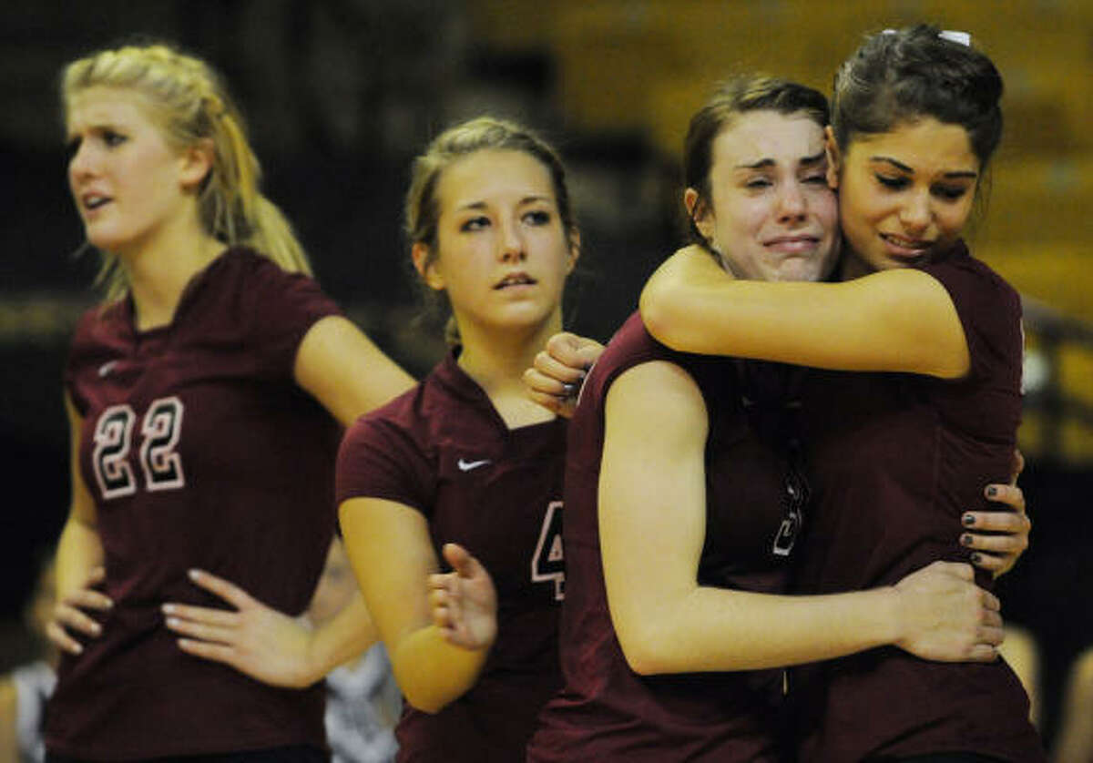 Cinco Ranch's Rachel Fairbanks and Ashley Meyer embrace after falling to Westlake in the Class 5A semifinals.