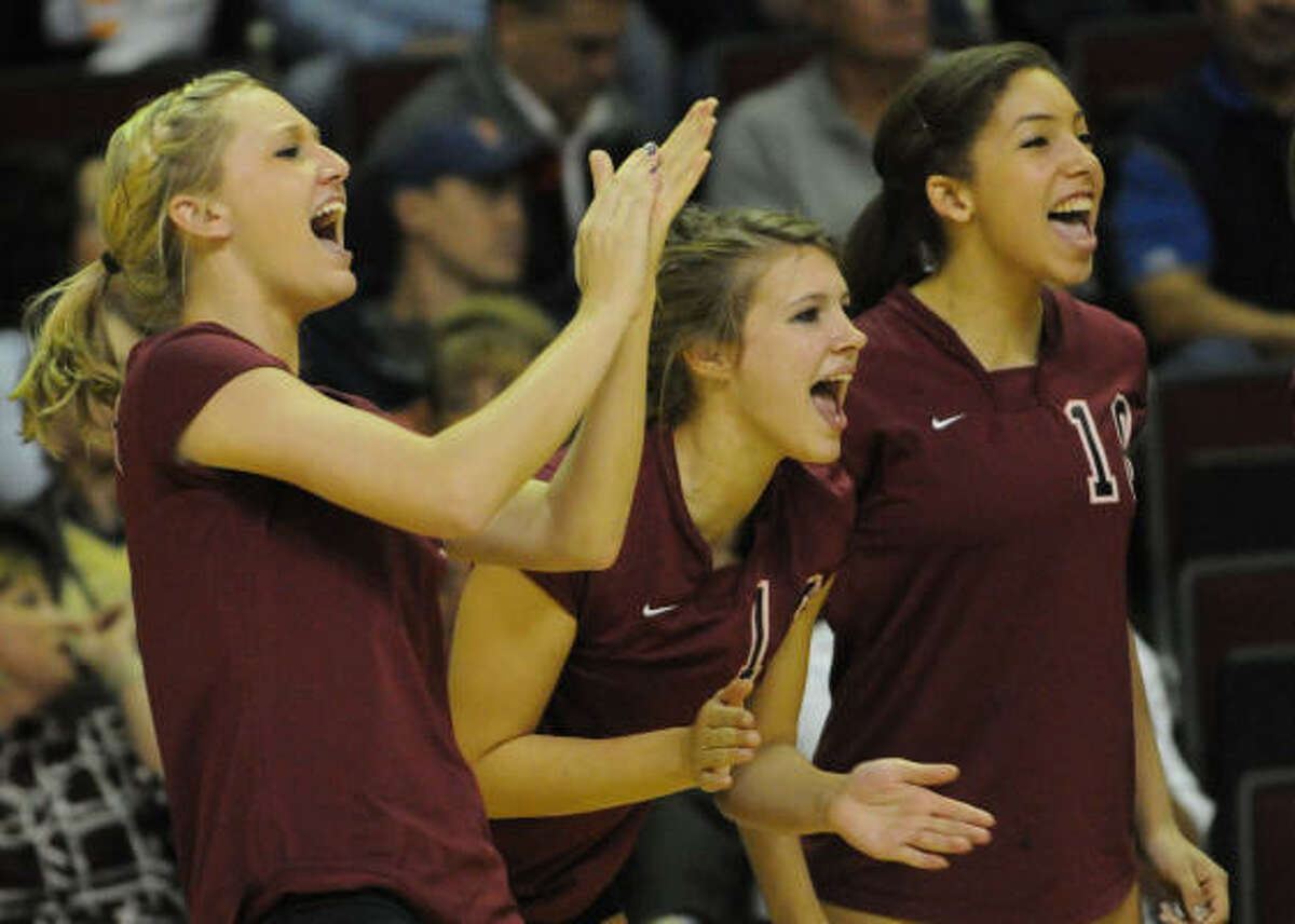 (From left) Cinco Ranch's Shayla Maldonado, Bethany Holub and Kierstyn Gimore celebrate a point late in Friday's match.