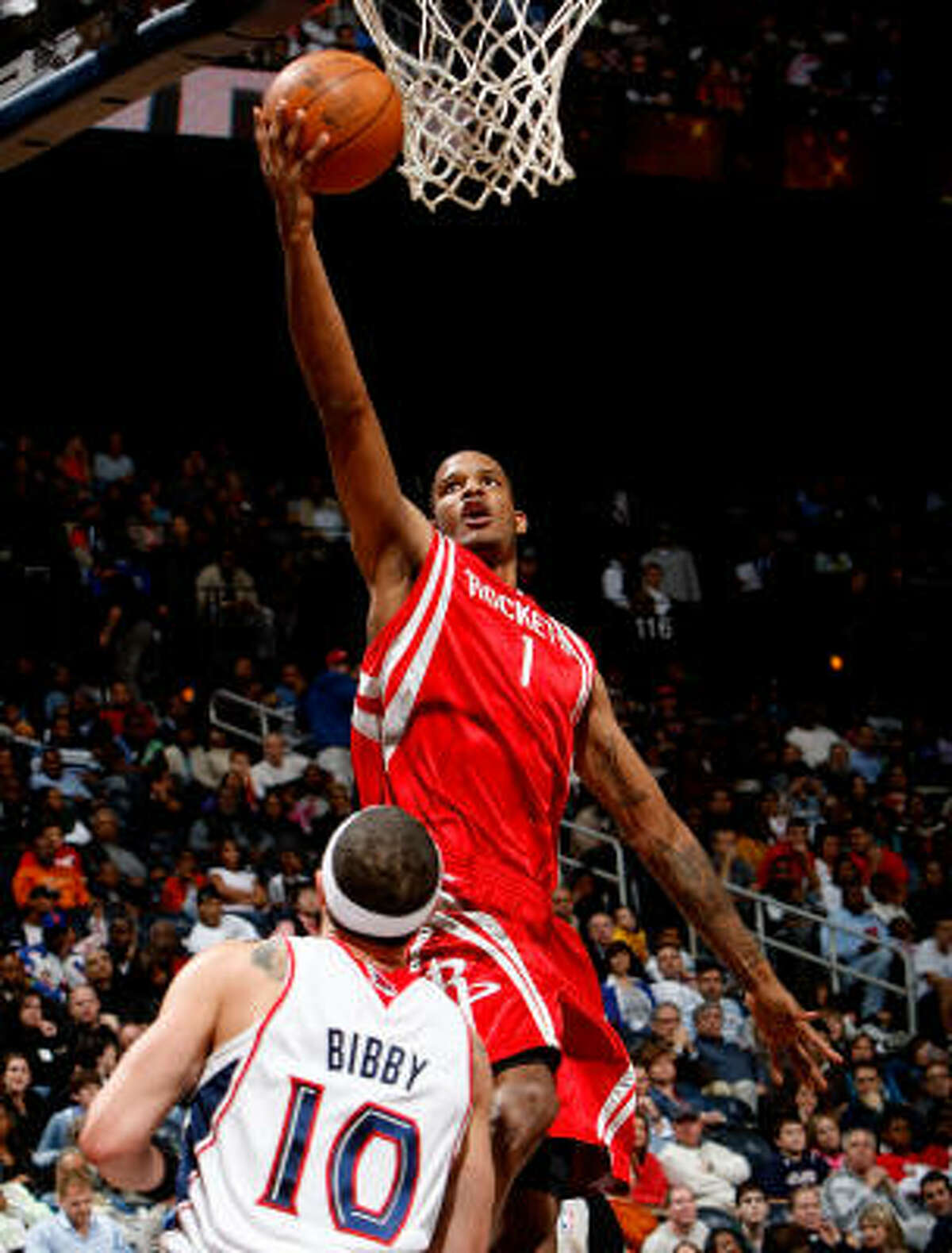 Rockets forward Trevor Ariza (1) shoots over Hawks guard Mike Bibby during Friday night's game in Atlanta.