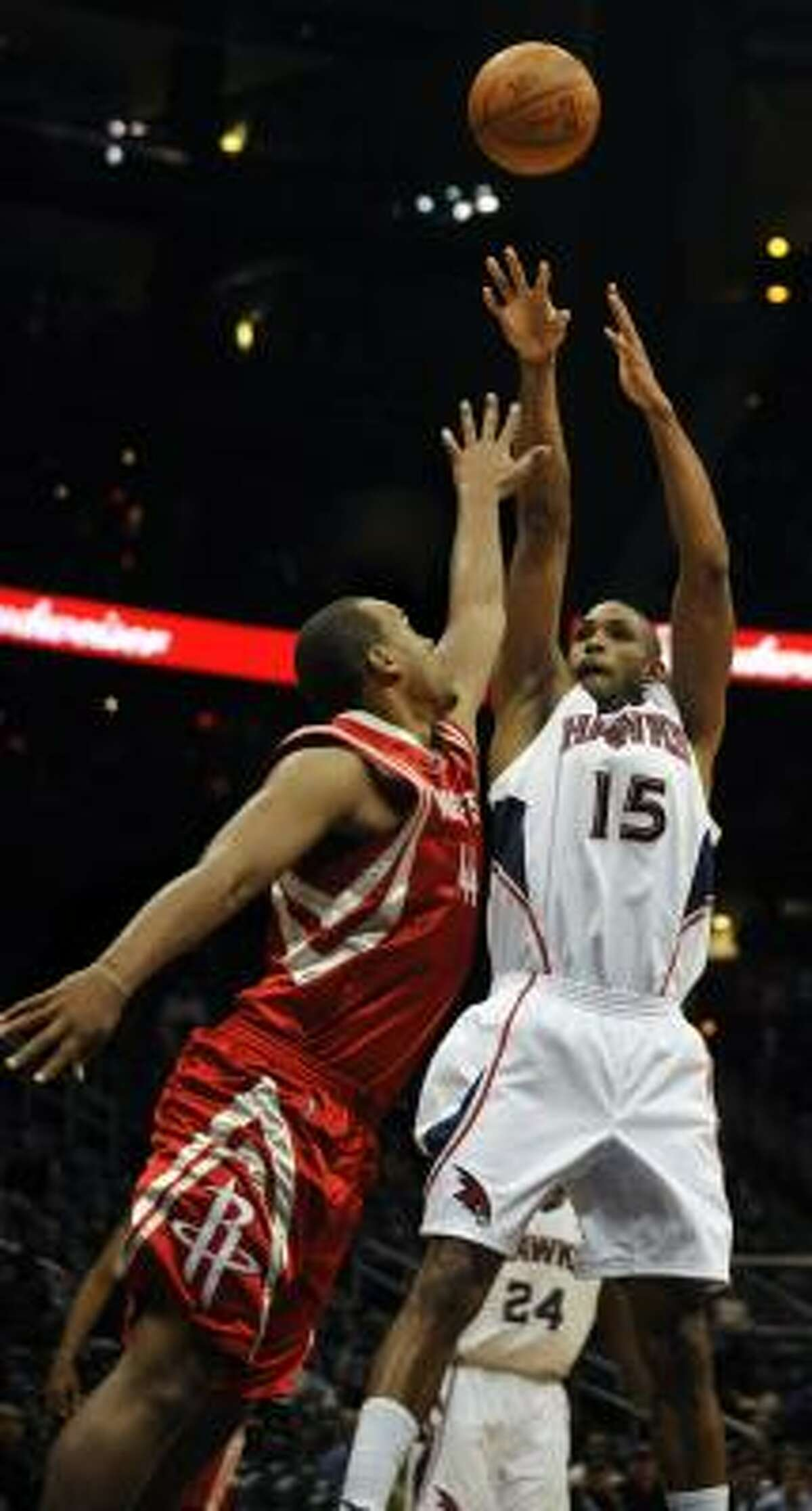 Hawks center Al Horford (15) takes a shot overcRockets center Chuck Hayes during the first quarter.